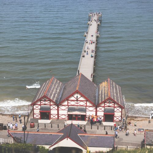 Red and white pier on the ocean in Saltburn-by-the-Sea, England