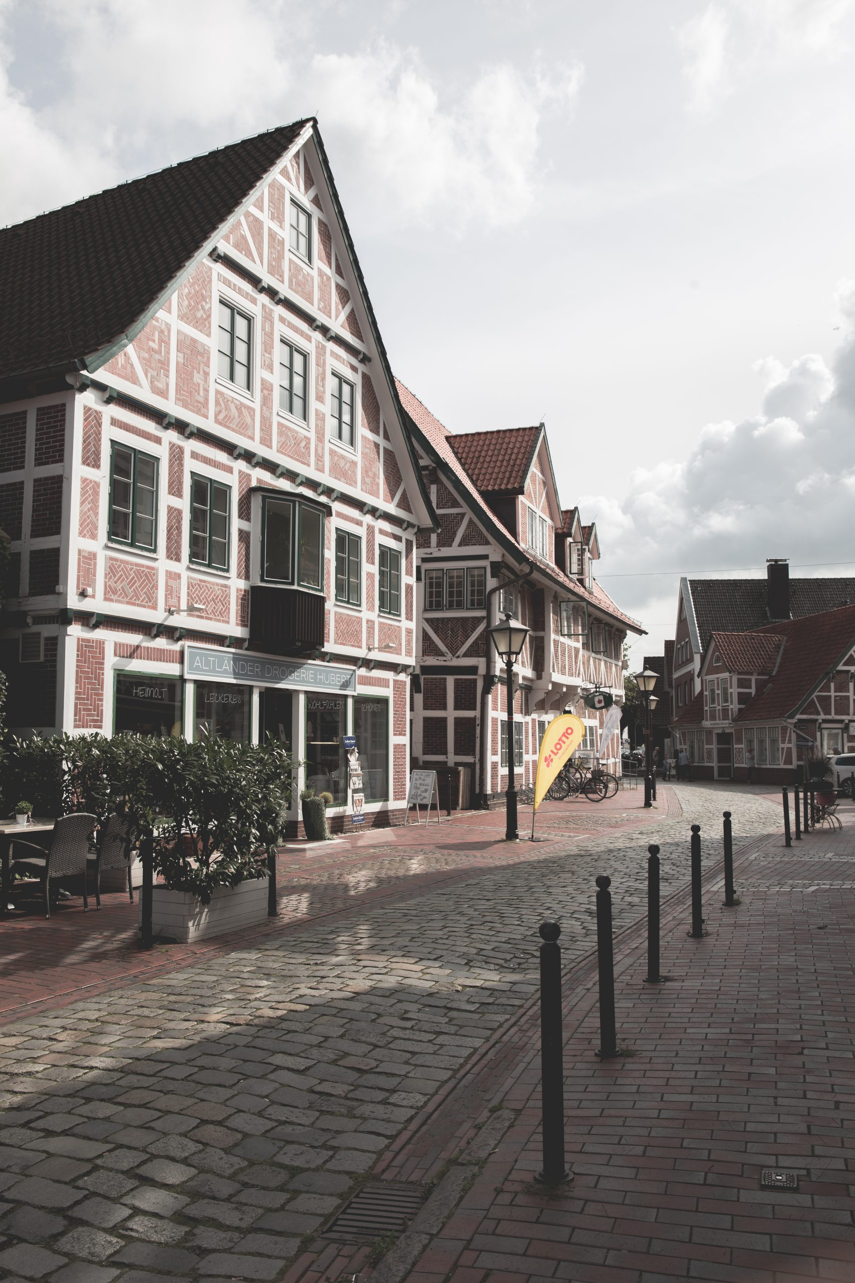 The Main Street in Jork, a town in Altes Land, Germany surrounded by red and white half-timbered houses