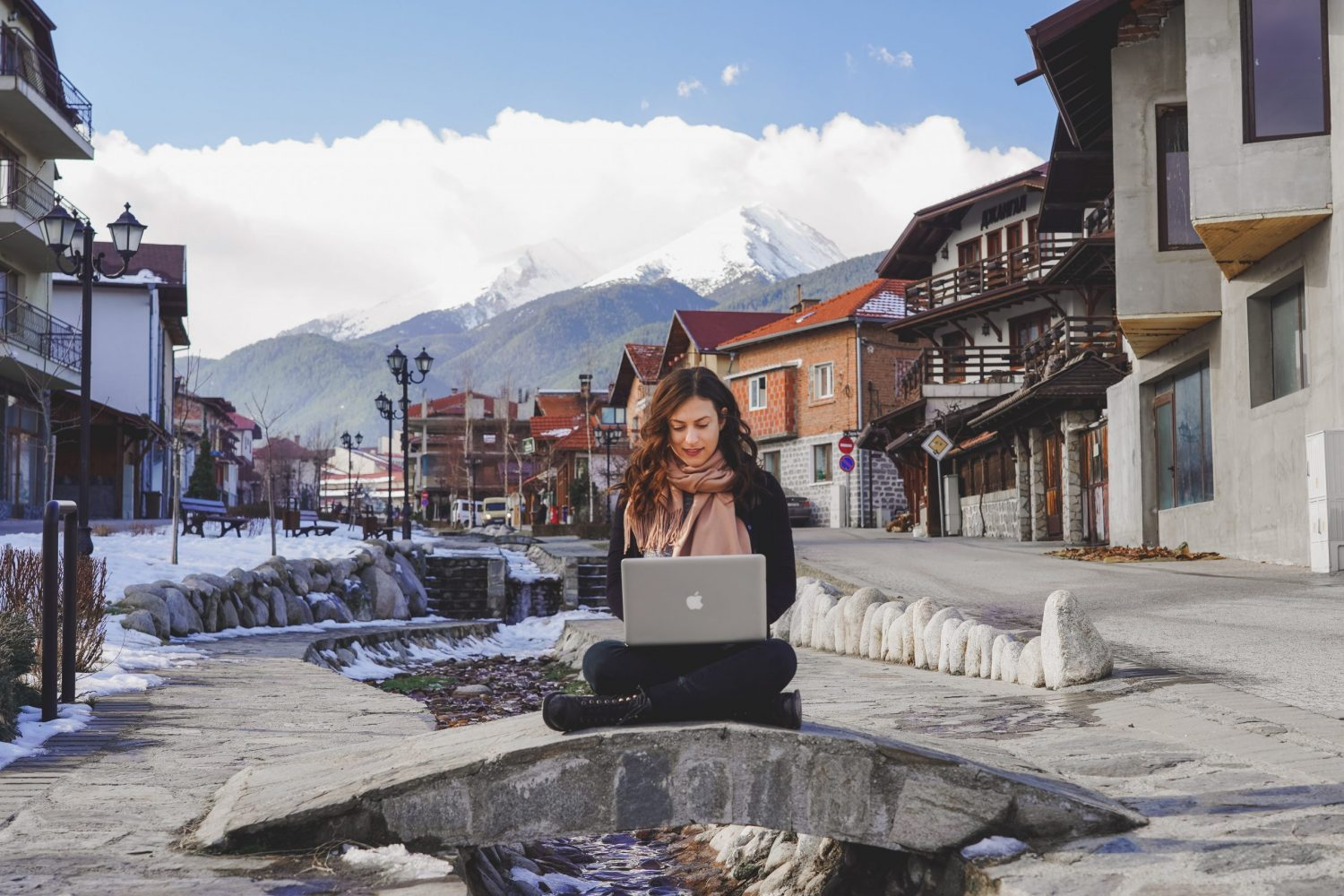 Digital nomad working on a laptop in Bansko, Bulgaria - tips for becoming a digital nomad!