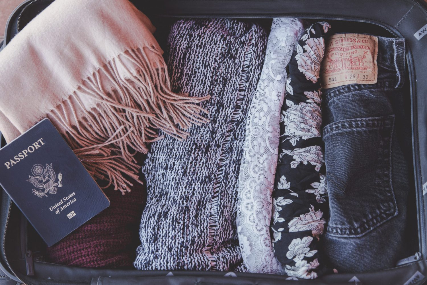 Clothes in a suitcase - consider what to keep before becoming a digital nomad.