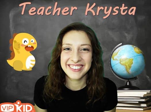 VIP Kid online English teacher with a background of a chalkboard, Dino, and globe on a stack of books that she created using a green screen!