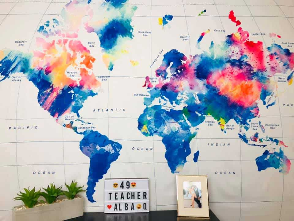 A large piece of fabric with a colorful world map is a great easy and simple background for VIP Kid online English teachers