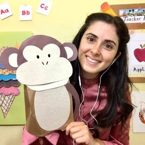 Online VIP Kid English teacher with background and a monkey prop