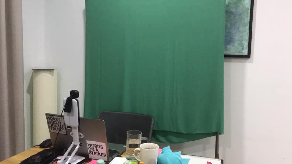 A green screen is a simple set up for VIP Kid online English teachers
