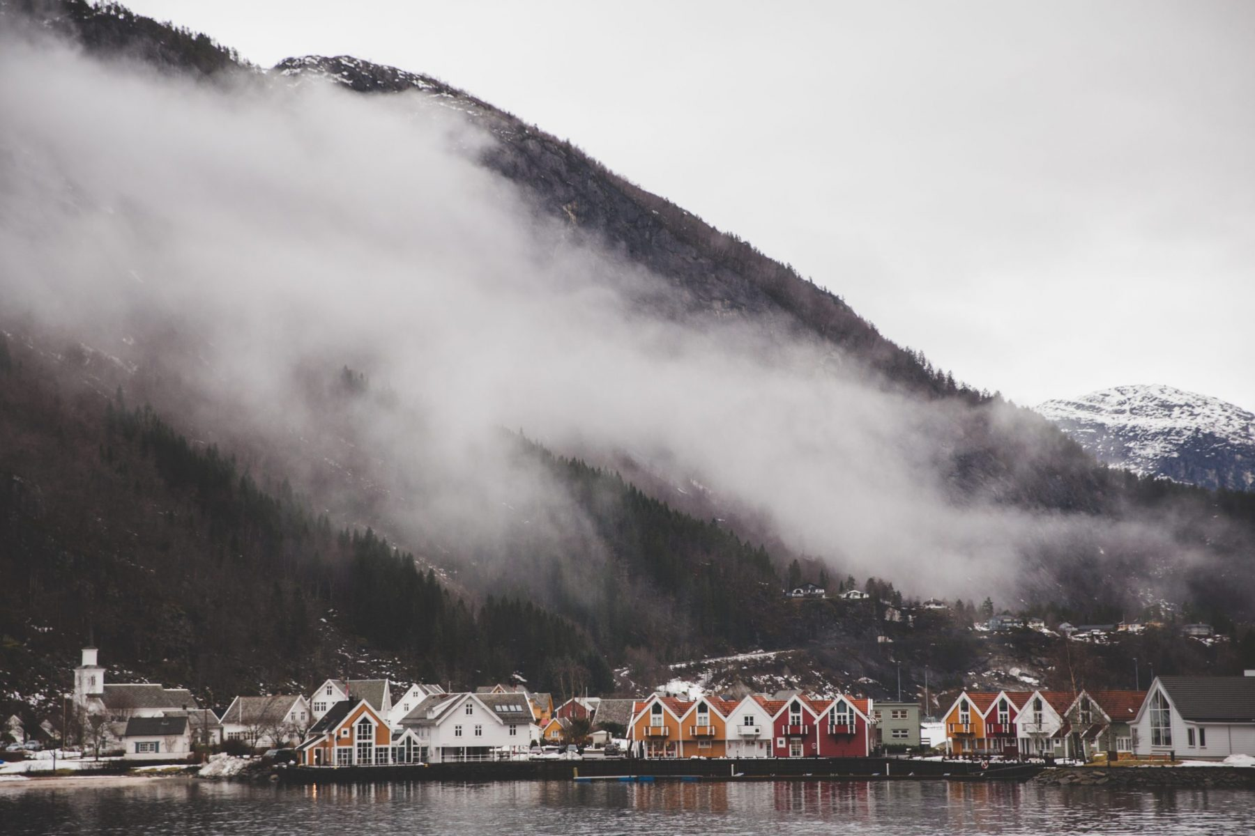Fog and mountains on a fjord cruise in the Osterfjord in Bergen, Norway in February