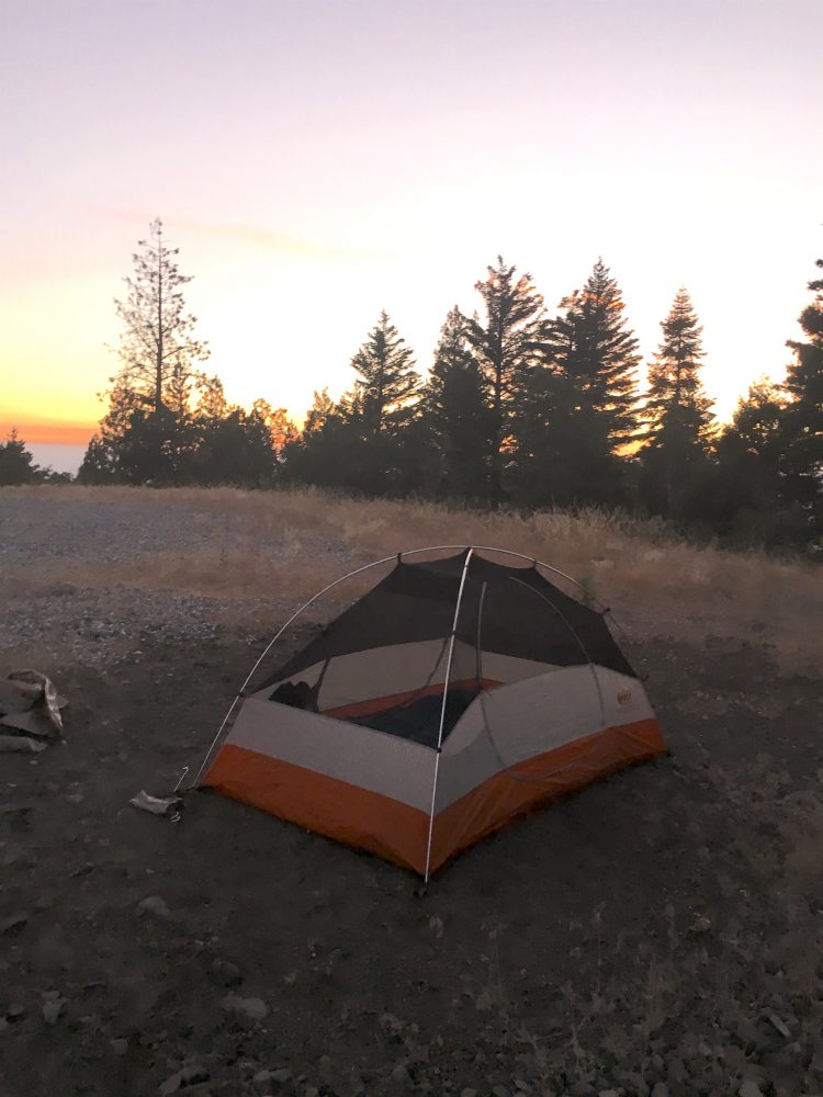 Orange Tent in the sunset in the wilderness