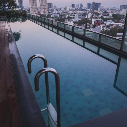 pool in Thailand on rooftop with view of buildings