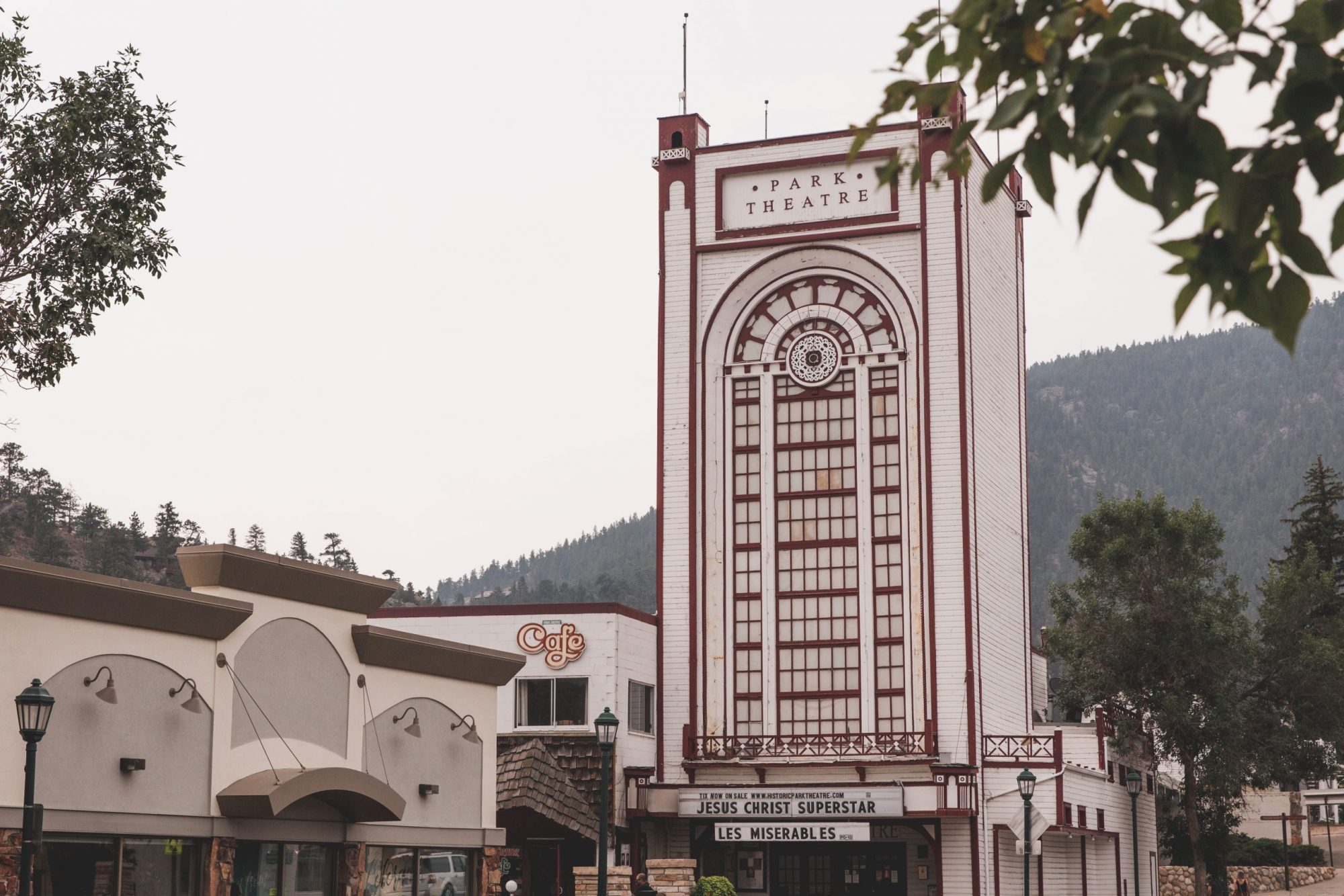 The Historic Park Theater in Estes Park, Colorado is a tall white and red western-themed building