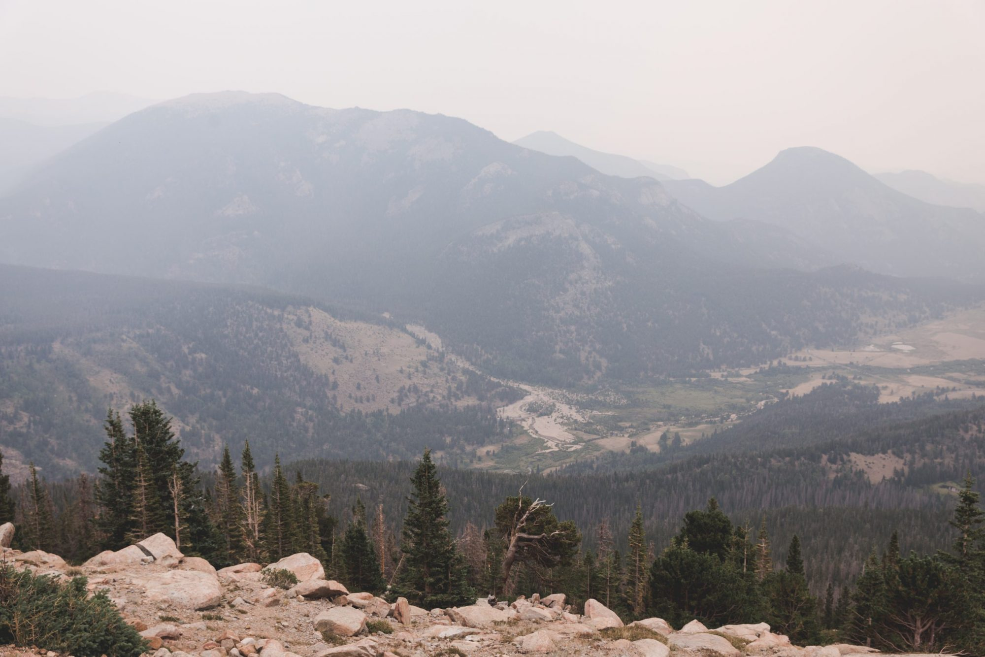 Rocky Mountain National Park Rainbow Curve Overlook has a view mountains and pine trees