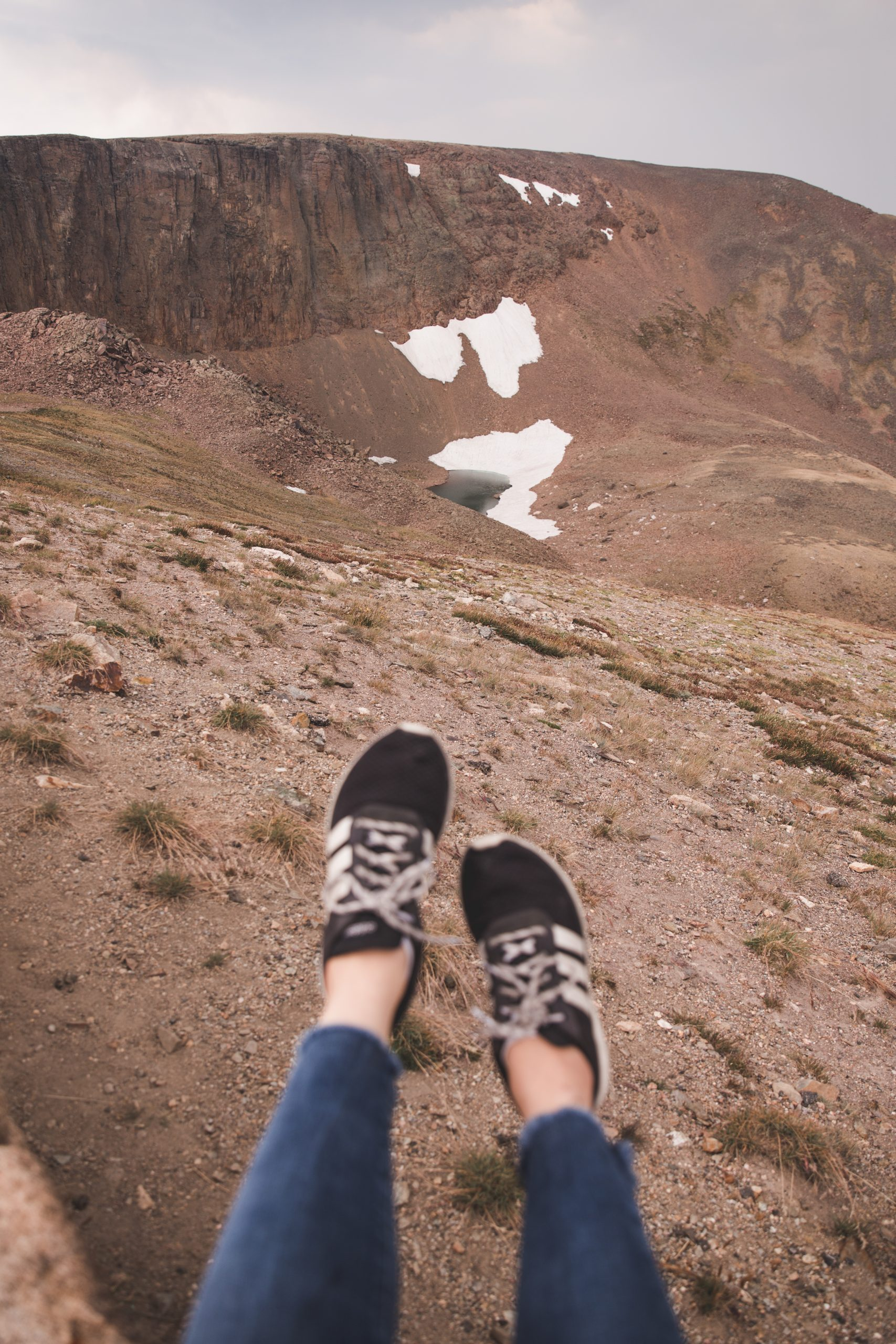 Kelsey's shoes with Lava Cliffs in Rocky Mountain National Park in the background