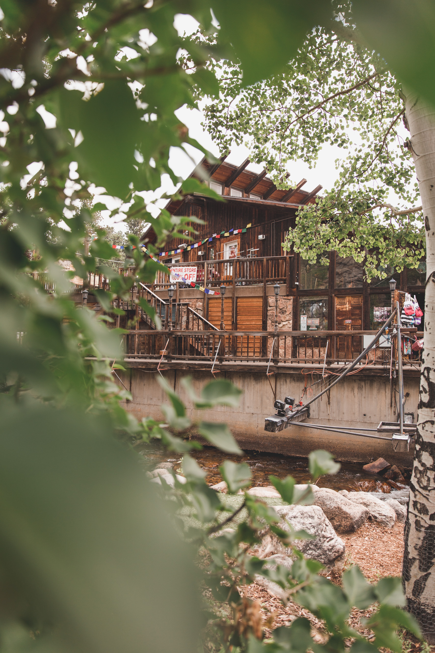 Wooden store with leaves in the foreground in Estes Park, Colorado