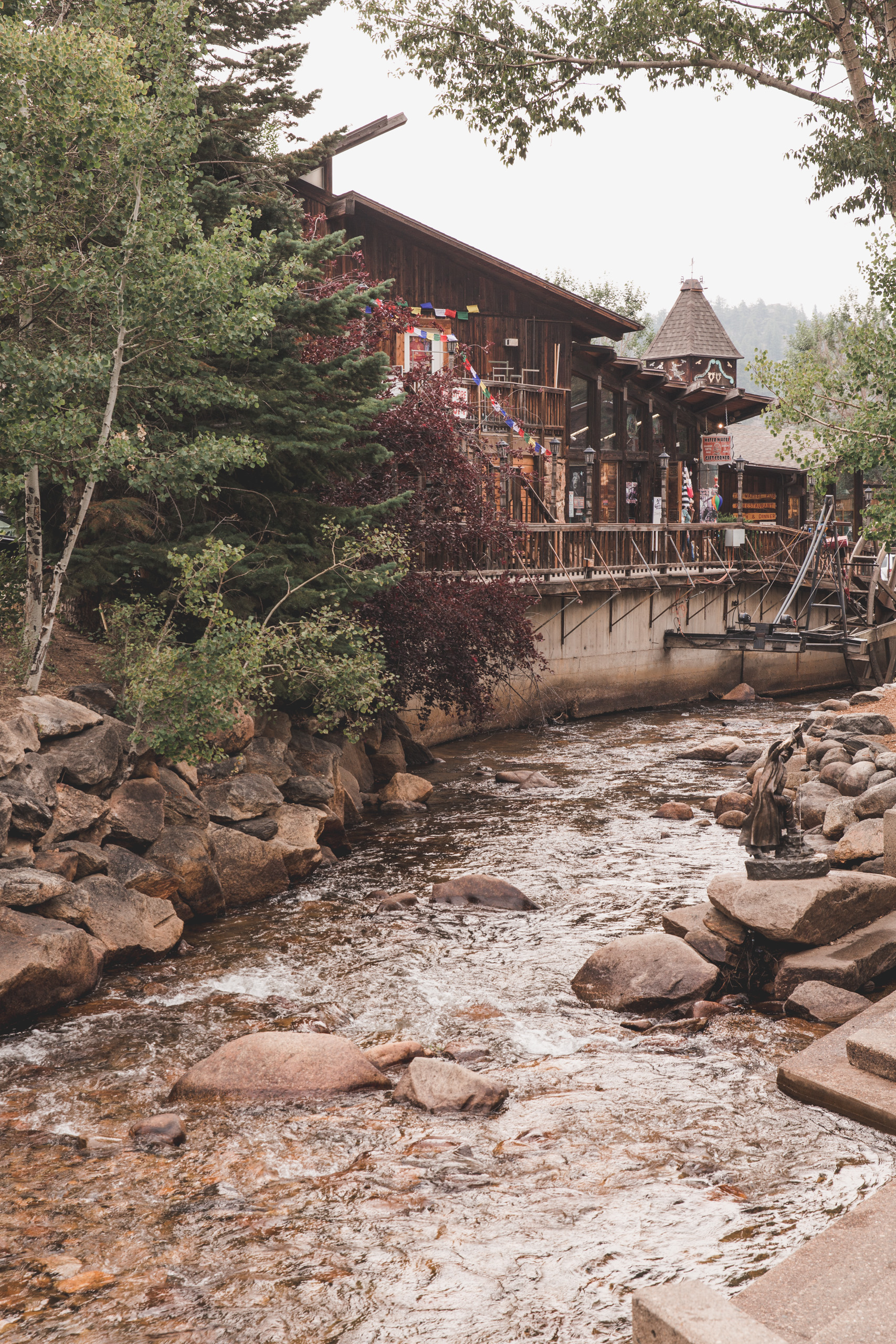 Wooden store on a river surrounded by trees and rocks in Estes Park in Colorado