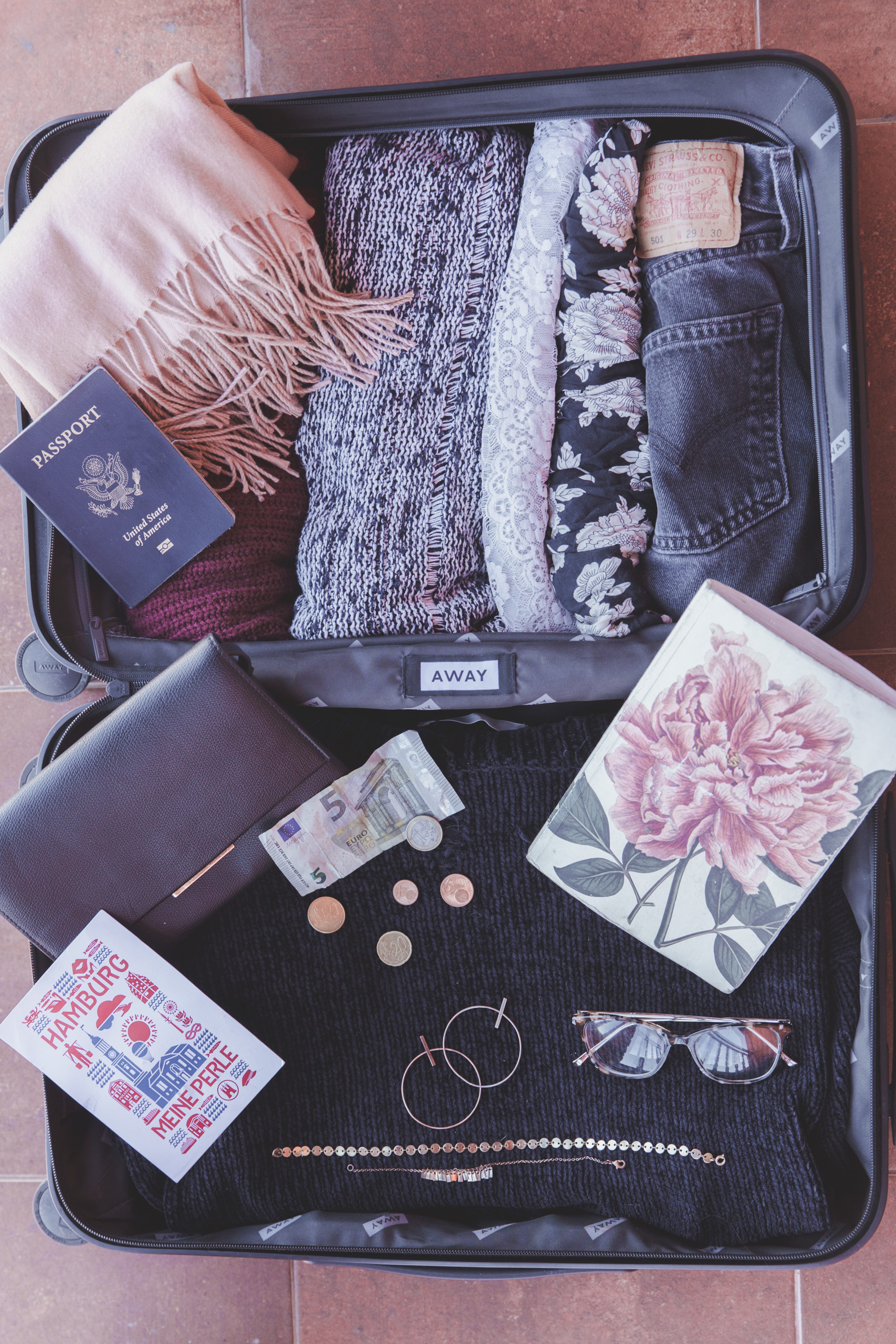 Clothes and other items in a carry on suitcase
