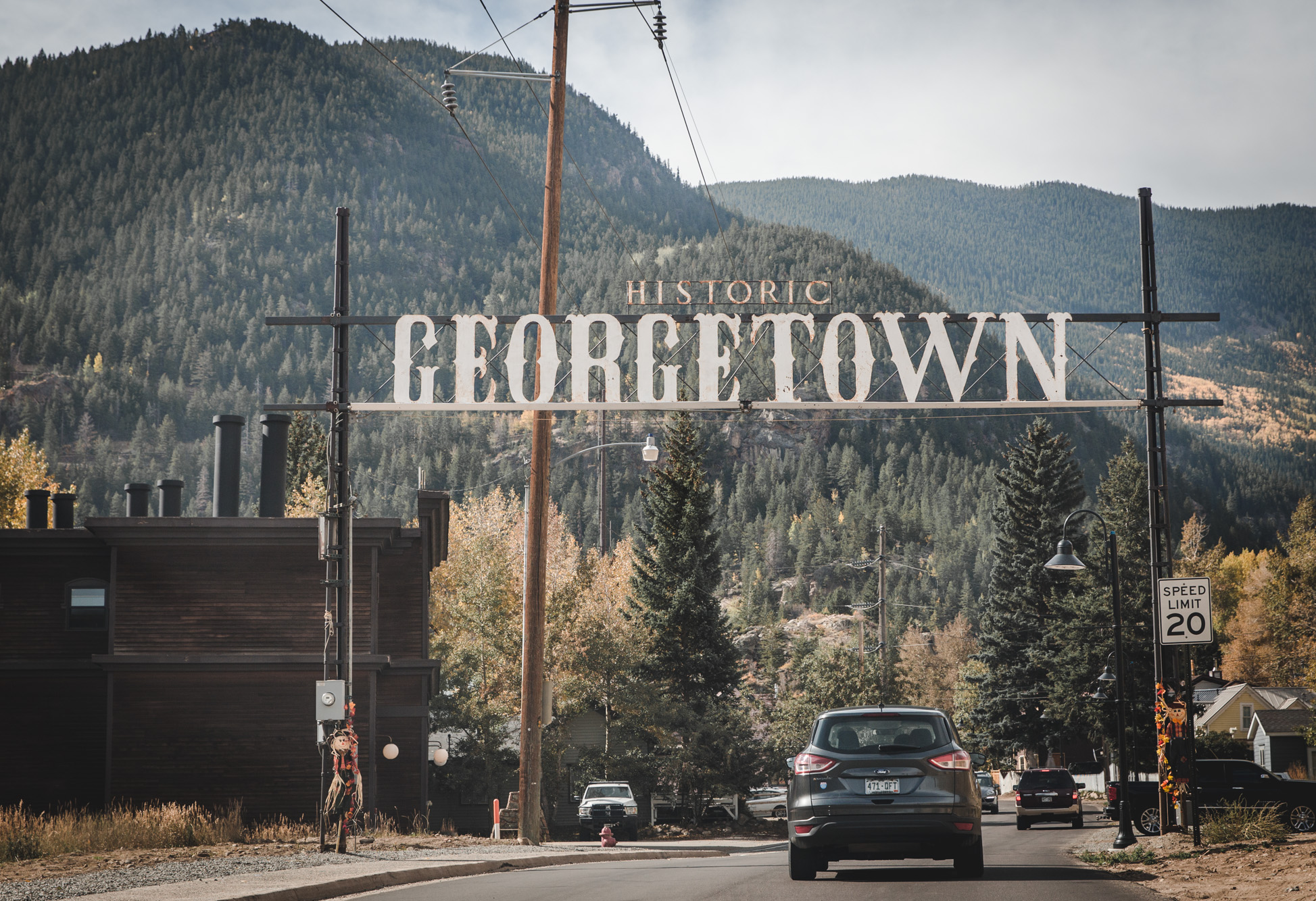 "Entrance sign that says ""Georgetown"" with mountains behind it in Colorado"