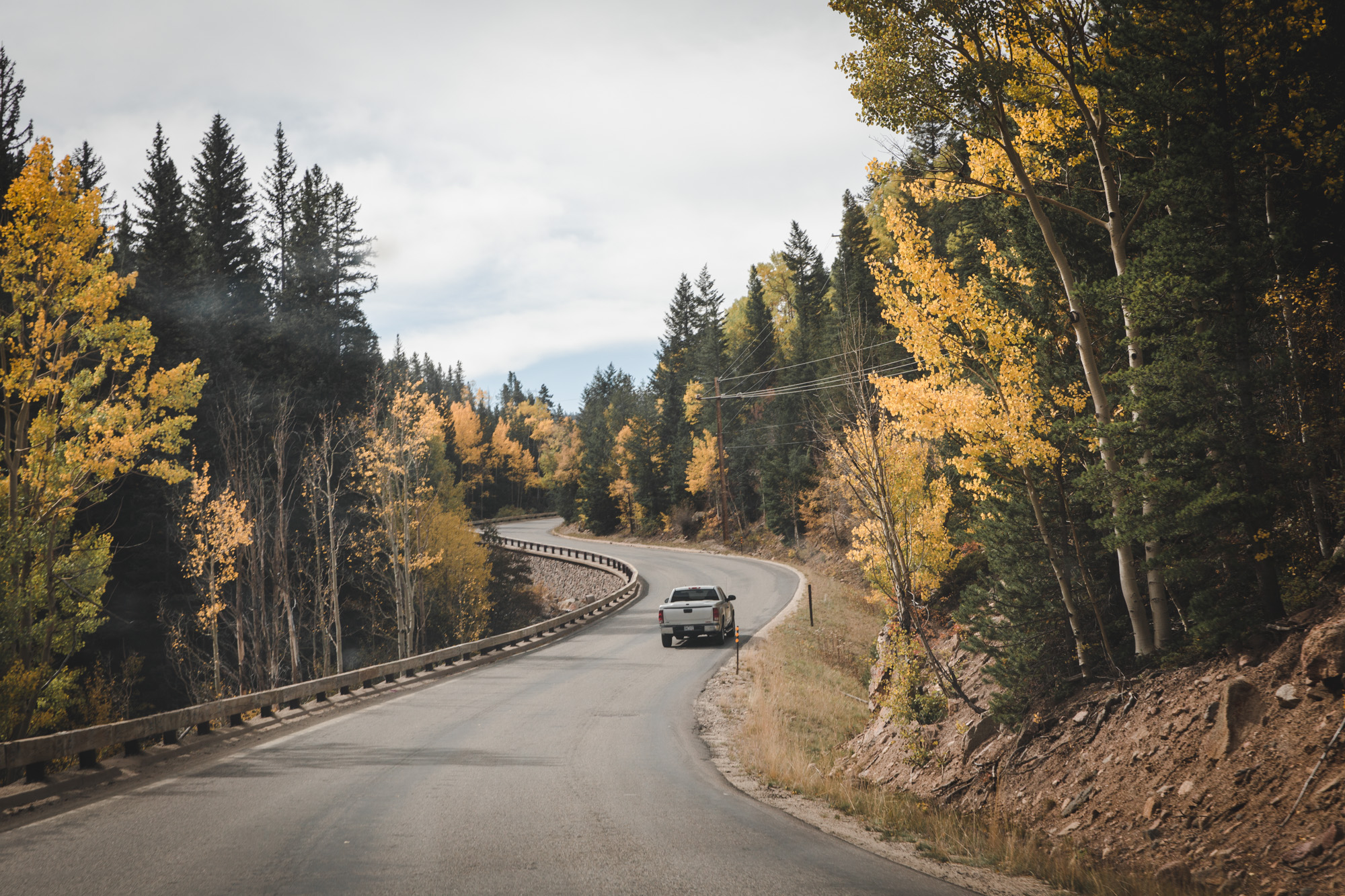 Guanella Pass in Colorado in fall, lined with yellow aspens and green pines