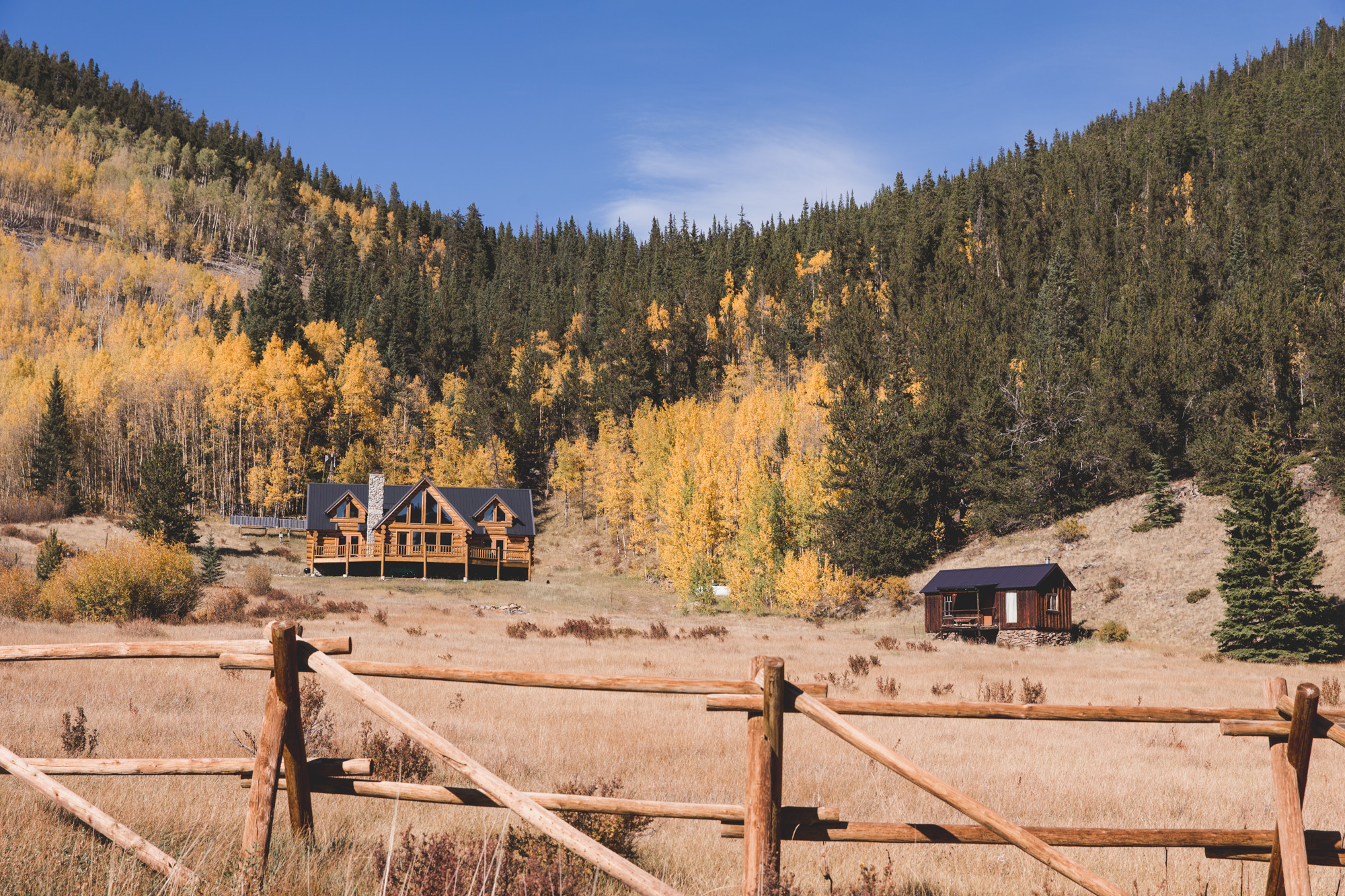 2 cabins with Yellow Aspens in the background on Guanella Pass, Colorado