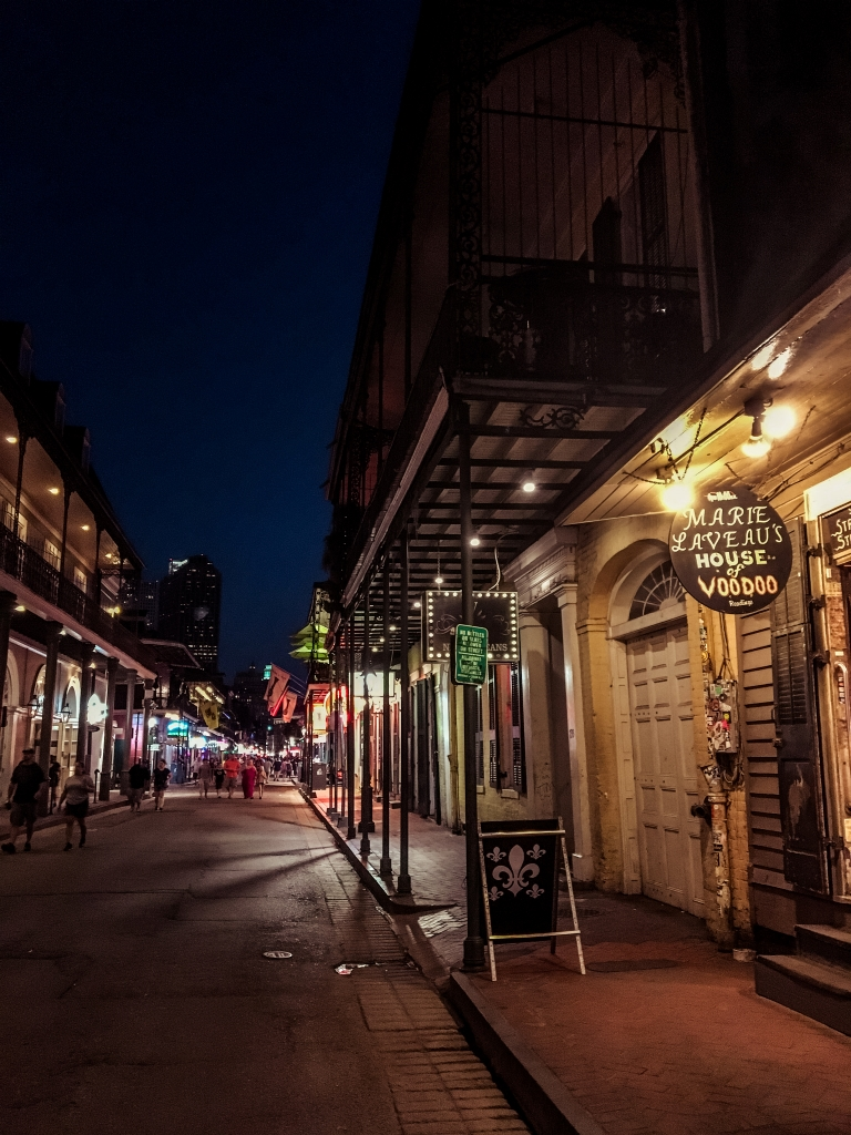 Dark street with the Marie Laveau House of Voodoo on it