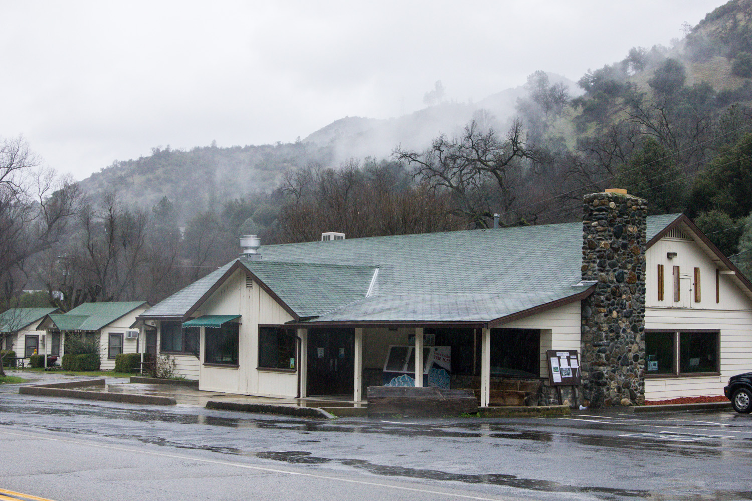 Store on Highway 140 in the fog and rain