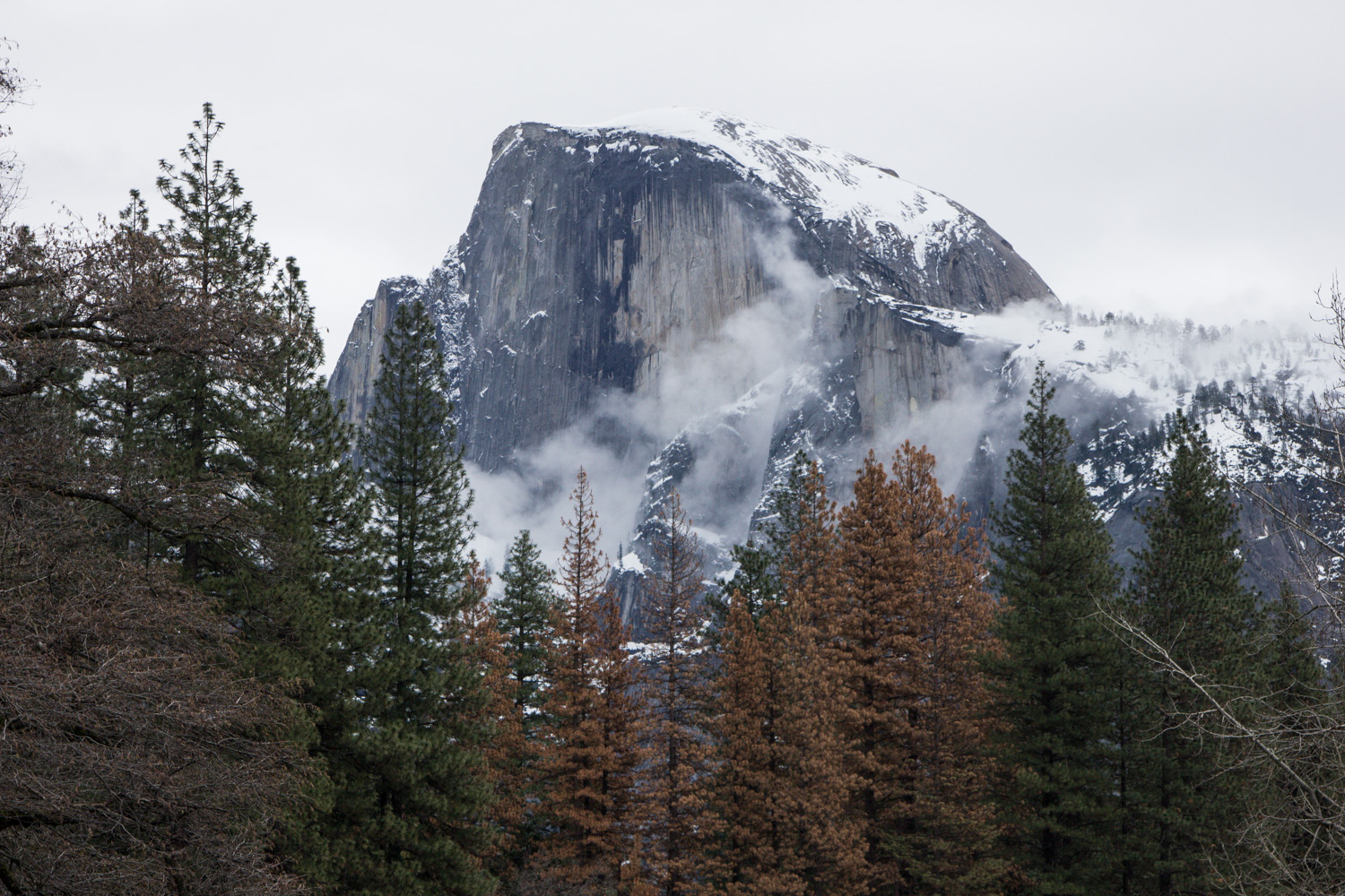 Half Dome covered in snow in the winter in Yosemite