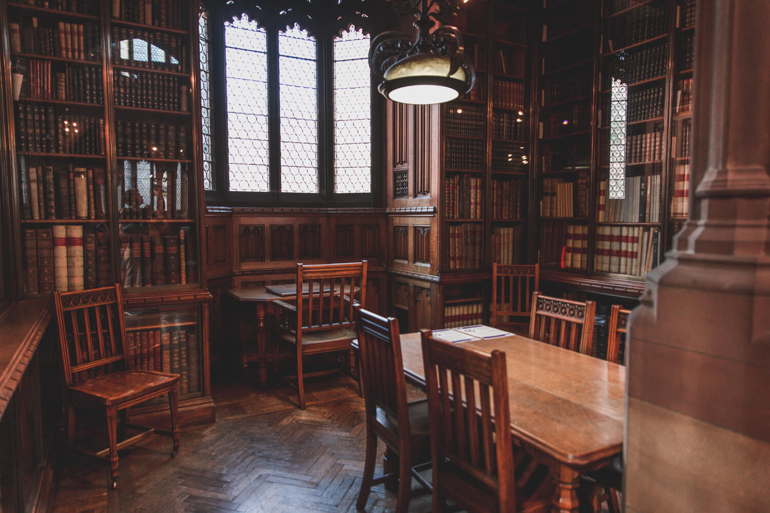 John Rylands Library in Manchester, UK is filled with pretty architecture, chairs, tables, and lights