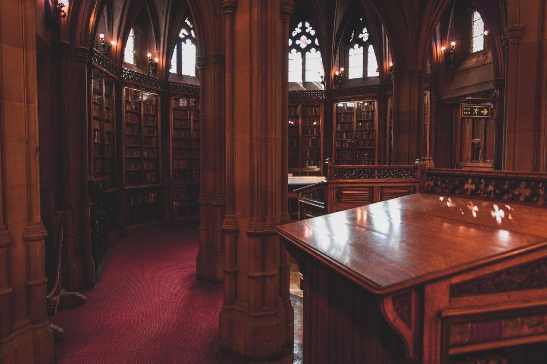 John Rylands Library desk, red carpet, and windows.