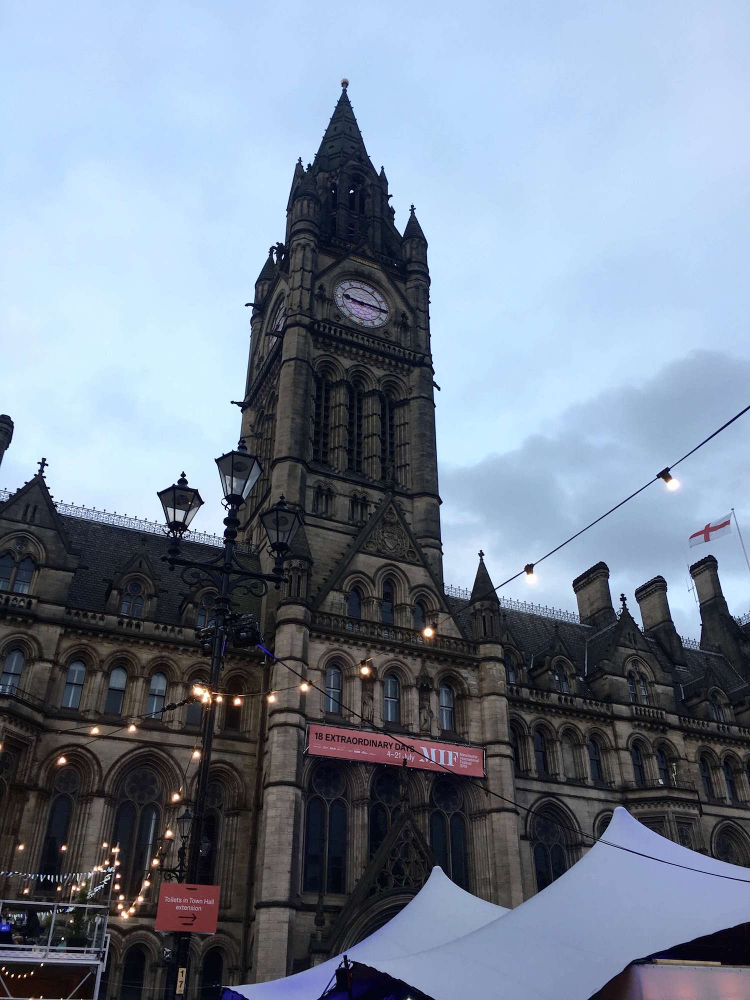 Manchester Town Hall at night with lights