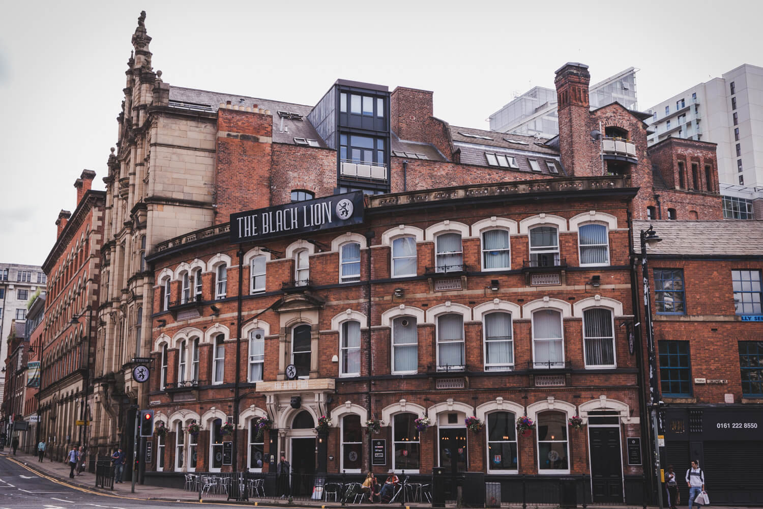 The Black Lion Manchester, UK with brick buildings